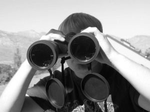 819685_boy_looking_through_binoculars.jpg